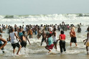 Revelers enjoy sun and water at Ghana's famous Labadi beach in Accra